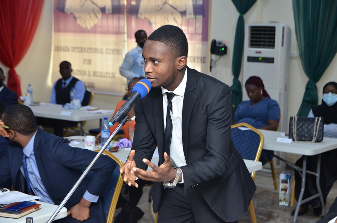 A young lawyer asking a question during the session.